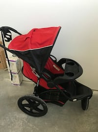baby's red and black jogging stroller Coaldale, T1M 1G8