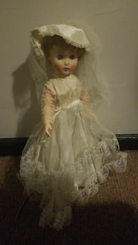 blonde haired female doll in white bridal gown