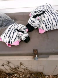 Large and small fuzzy zebra pillows.