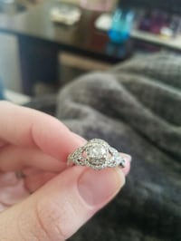 silver-colored clear gemstone encrusted solitaire 166 mi