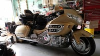 brown, silver and black touring motorcycle