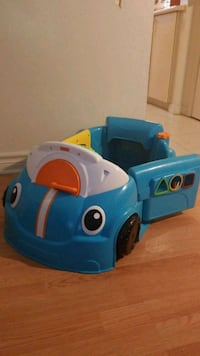 Blue toy car with new batteries  London, N5Z
