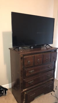 flat screen television with brown wooden TV stand Conroe, 77304