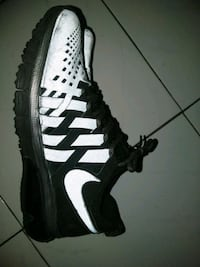 unpaired black and white Nike low-top sneaker