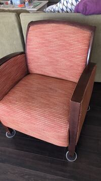 Brown wooden frame brown padded armchair really heavy and it is an excellent condition Baltimore, 21220
