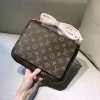 brown Louis Vuitton leather crossbody bag Toronto