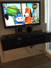 flat screen TV and black wooden TV stand Richmond Hill, L4C