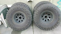 gray bullet hole car wheel with tire Seattle, 98103