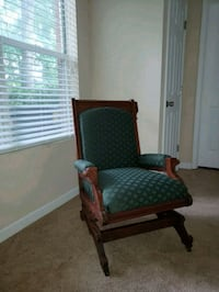 green and brown wooden armchair 244 mi