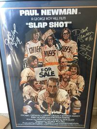 Putting On The Foil!! A hockey fans masterpiece. Nicely framed Slap Shot movie poster signed by all 3 Hanson Brothers. Truly one of a kind. West Hollywood, 90069
