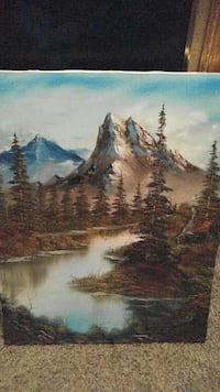 mountain near bodies of water painting
