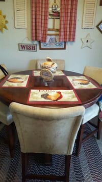 Pub height round kitchen table and 4 stools.  Leland, 28451