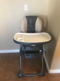 baby's white and gray highchair