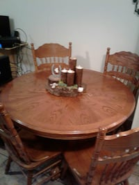 round brown wooden table with four chairs dining set Davie