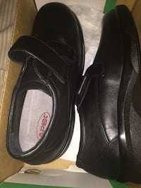 Black leather strap on shoes