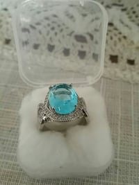 women's silver and blue ring with case