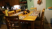 rectangular brown wooden table with six chairs dining set Moreno Valley, 92557