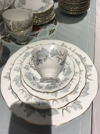 """Vintage Royal Albert """" Silver Maple """" gold trim made in England; 8 place settings plus either tea pot or coffee pot , fabulous condition no chip or crack.  Hamilton, L9A 1T3"""