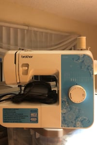 Brother sewing machine with singer sew essential kit.