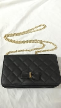 Quilted black leather crossbody bag with gold-colored sling Surrey, V3W 5J2