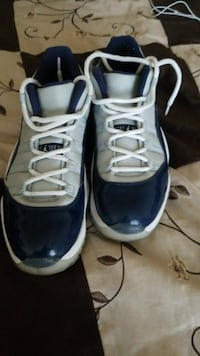 pair of blue-and-white Air Jordan 11 shoes