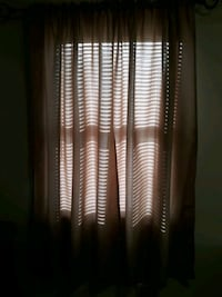 2 curtain panels each panel is 40x63...tan color New Columbia, 17856