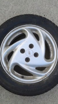 chrome 5-spoke car wheel with tire Shelby charter Township