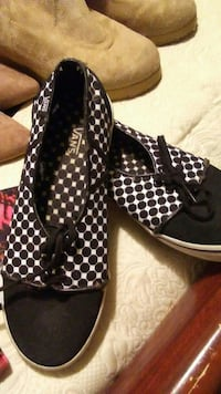 pair of white-and-black polka-dotted Vans sneakers