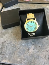 round gold chronograph watch with gold link bracelet Lake Worth, 33461