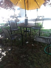 6 chairs 1 patio table matching set with umbrella Boise, 83703