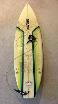 white and green surf board