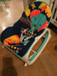 baby's white and blue Fisher-Price bouncer chair