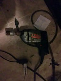 black and gray corded power drill