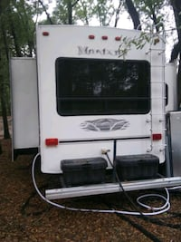06 Montana 5th wheel has three slide outs has an electric fireplace