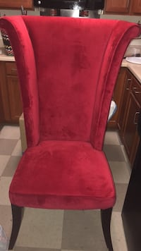 Red fabric padded brown wooden chair Arlington, 22204