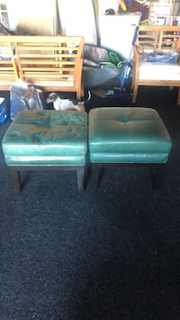 Two turquoise Ottomans