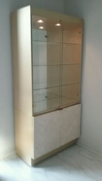 brown wooden framed glass display cabinet Pikesville, 21208