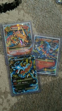 Three Mega Charizard cards in pro loaders Bridgeport, 06610