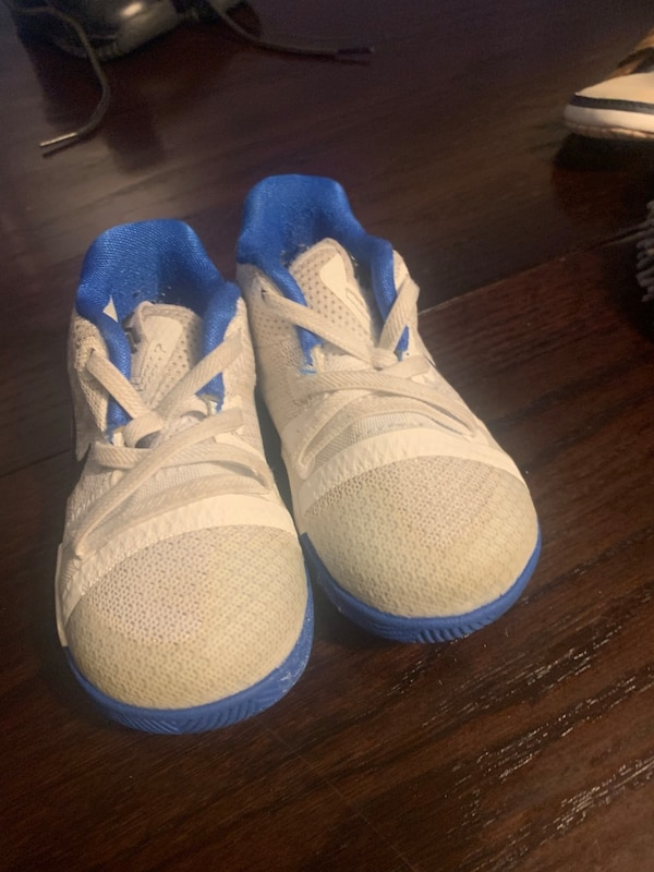Pair of white-and-blue sneakers