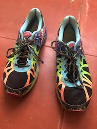 Pair of blue-and-green ASICS running shoes