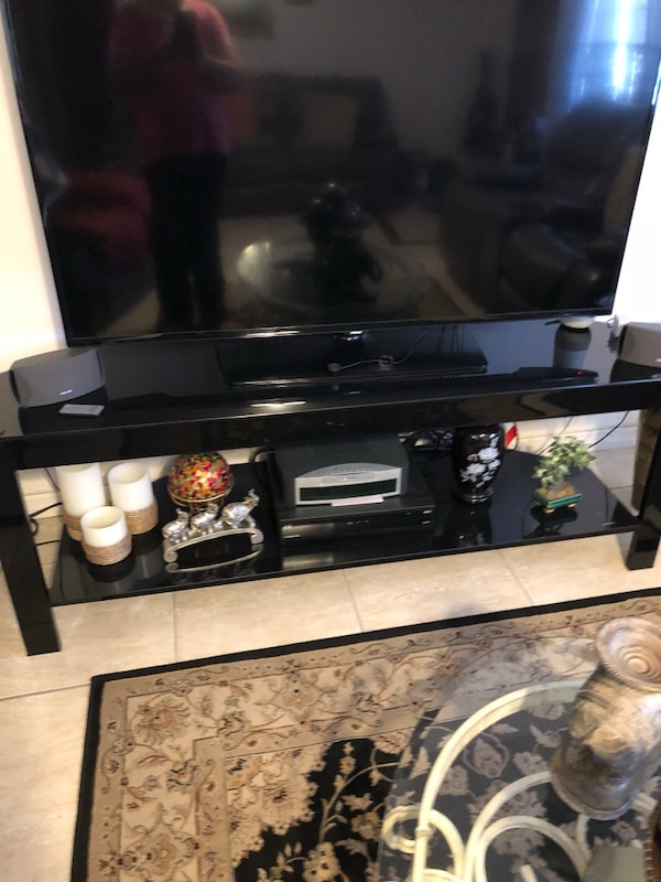 it's not the TV just the table is like 60 or 62 long
