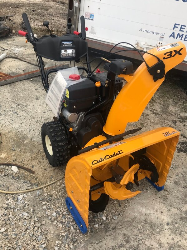 New never used snow blower