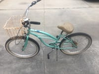 green and white beach cruiser bike
