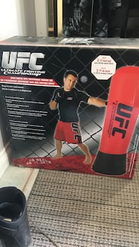 red and black UFC free standing heavy bag box