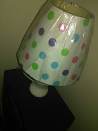 white, blue, green, and purple polka-dot table lamp