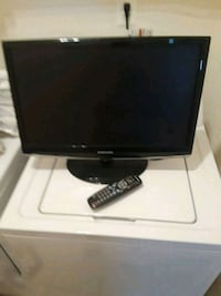 black flat screen TV with remote Occoquan, 22125
