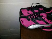 pair of pink-and-black Nike running shoes Toledo