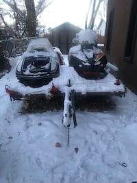 Two snowmobiles and a trailer   Grand Junction, 81503