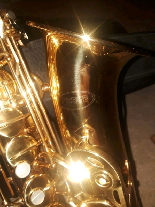 brass-colored saxophone in case