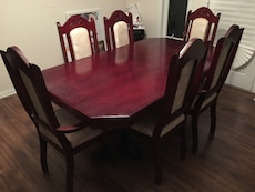 red wooden dining table